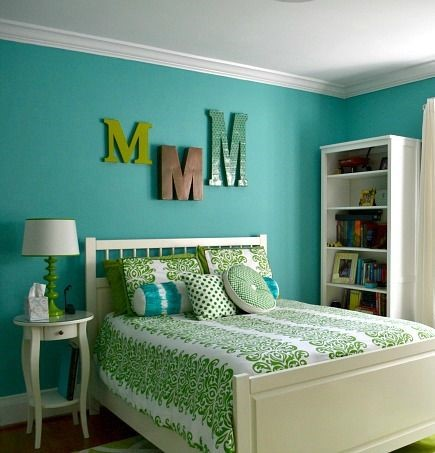 An image of bedroom in emerald green colors