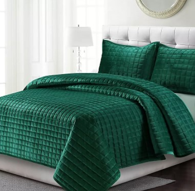 a beautiful square box stitching of emerald green quilt