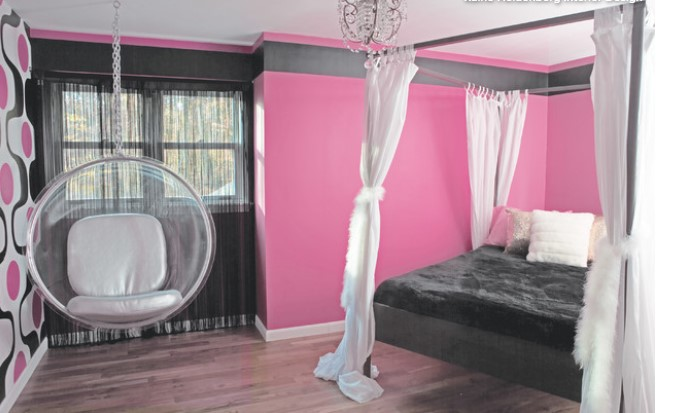 pink bedroom with black curtains