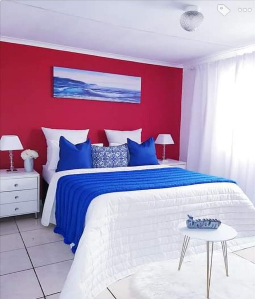 a combination of ruby red and sapphire blue in bedroom