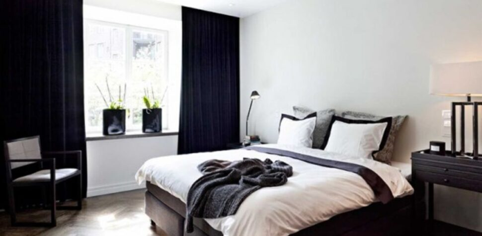 white walls and black bedroom curtains
