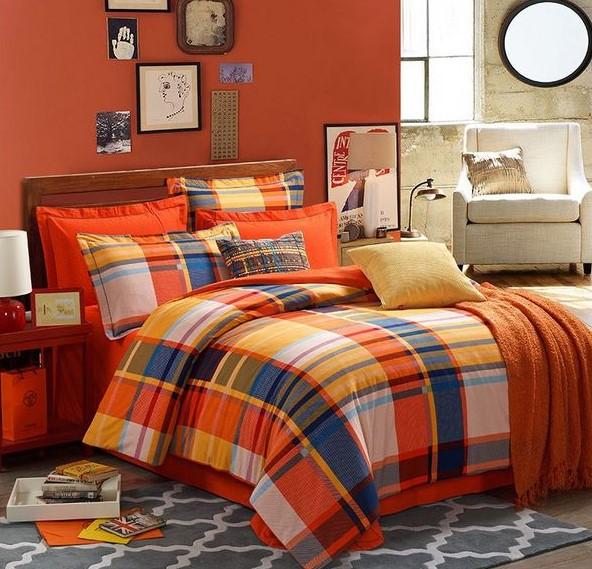 orange duvet cover, pillows, and burnt orange wall
