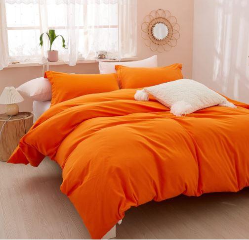 orange duvet cover white pillows
